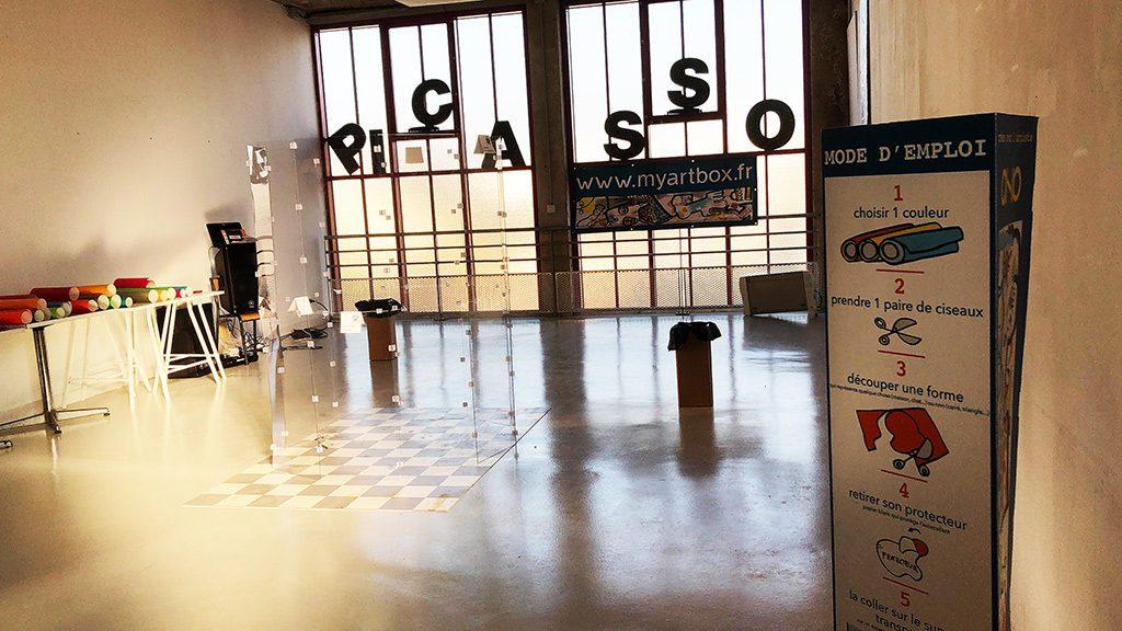 mise en place du tube géant fresque serious play lors d'un team building art à Rennes par aNa artiste et myartbox